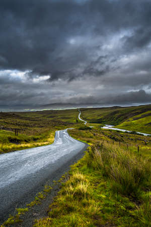 Abandoned Single Track Road Through Scenic Hills On The Isle Of Skye In Scotland Reklamní fotografie
