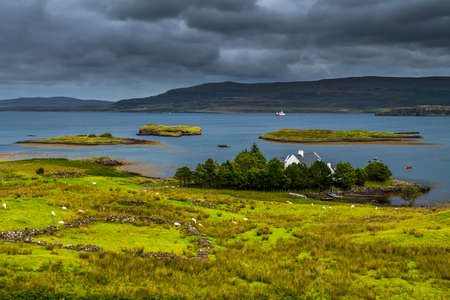 Scenic Landscape With House And Small Harbor At The Coast Of The Isle Of Skye In Scotland