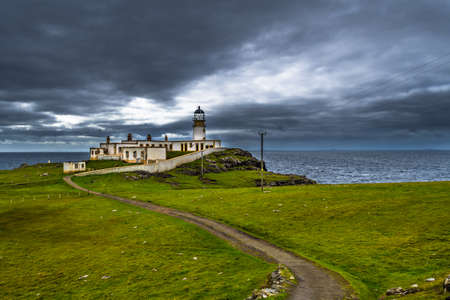 Lighthouse Of Neist Point At The Coast Of The Isle Of Skye In Scotland