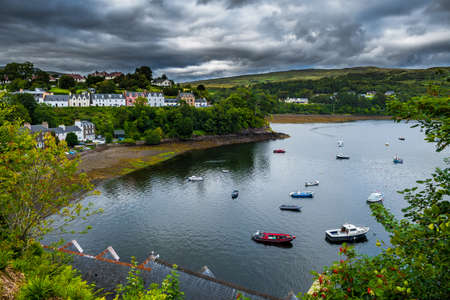 Harbor And Picturesque Houses In The City Of Portree On The Isle Of Skye In Scotland