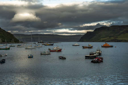 Boats In The Harbor Of Portree On The Isle Of Skye In Scotland