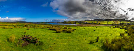 Old Rusty Vintage Plough On Green Pasture With Sheep At The Coast Of The Isle Of Skye In Scotland Reklamní fotografie