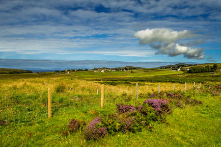 Scenic Landscape With Picturesque Settlement At The Coast Of The Isle Of Skye In Scotland