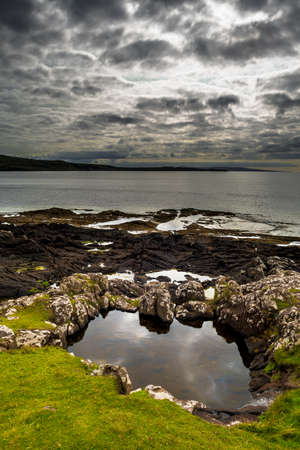 Picturesque Coast With Small Grassy Ponds On The Isle Of Skye In Scotland