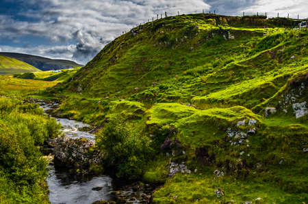 Wild Creek Flows Through Scenic Valley With Remote House On The Isle Of Skye In Scotland Reklamní fotografie