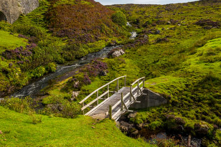 Small Wooden Bridge Over Wild Creek On The Isle Of Skye In Scotland