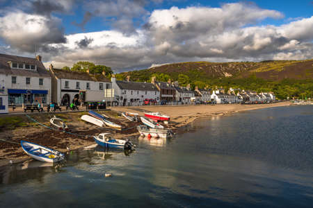 City Of Ullapool With Old Fishing Boat At Loch Broom In Scotland
