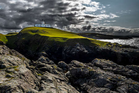 Strathy Point Lighthouse On Top Of Wild Cliffs At The Atlantic Coast Near Thurso In Scotland
