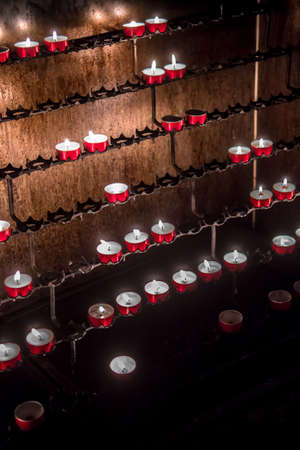 Red Memory Candles Burning In Chapel