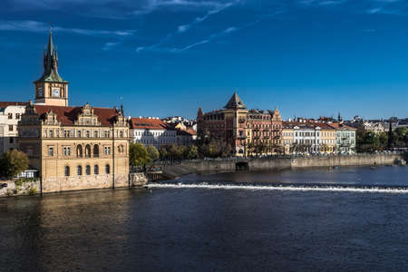 Moldova River And Historic Buildings In Prague In The Czech Republic