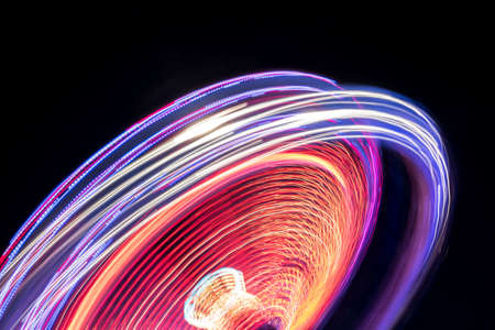 Colorful Light Trail From A Fast Carrousel At A Fun Park In The NIght