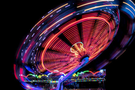 Colorful Light Trail From A Fast Carrousel At A Fun Park In The NIght Stock fotó
