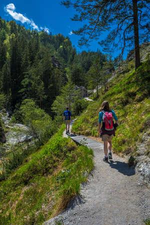 Young People Walk On Mountain Hiking Trail In Ötschergräben In Austria