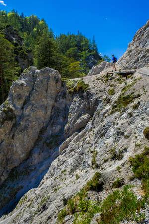 Young Man Walks On Rocky Hiking Trail In Ötschergräben In Austria Banco de Imagens