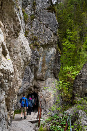 Group Of People On Hiking Trail Enters A Cave In Ötschergräben In Austria