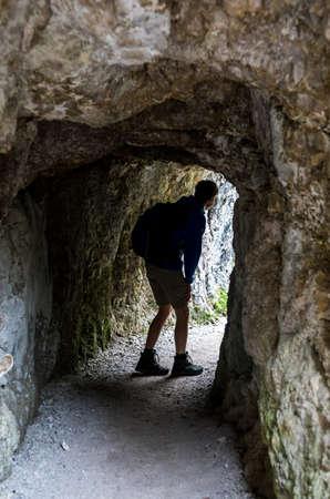 Man On Hiking Trail Leaves A Cave In Ötschergräben In Austria