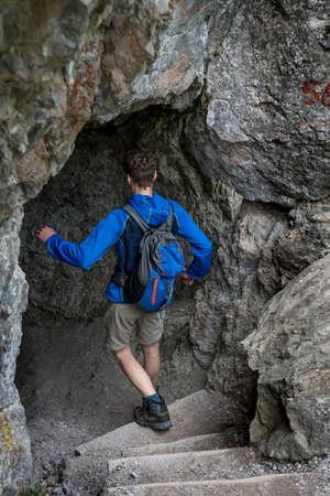 Man On Hiking Trail Enters A Cave In Ötschergräben In Austria