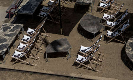 Abandoned Beach Bar With Empty Deck Chairs During Corona Crisis Editorial