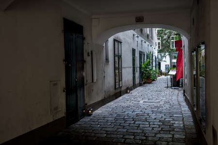 Entrance To The Backyard Of A Historic Building With A Picturesque Restaurant In The Inner City Of Vienna In Austria Editorial