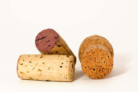 Macro of three different wine cork, isolated on white