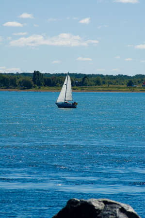 A little sail boat sailing on the river