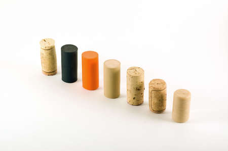 A variety of different wine cork standing arranged in a row