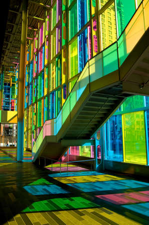 Shot taken under colorful stairs in a convention center Stock Photo