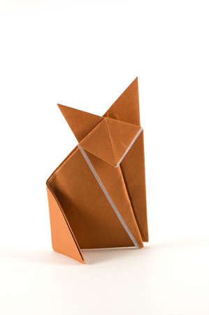 origami paper: A fox origami made of a brown sheet of paper Stock Photo