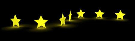 a row of yellow glowing star sitting on the ground