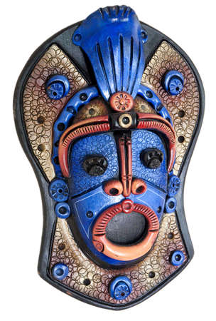 a colorful wooden mask from south america isolated on a white background