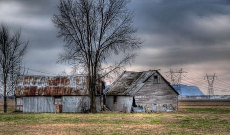 an hdr photo treatment on a old barn isolated in a field