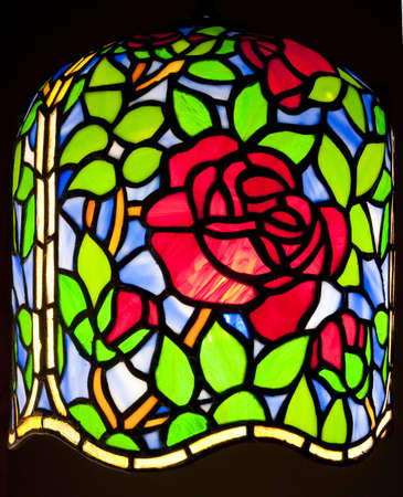a tiffany lamp with rose pattern isolated on black Stock Photo