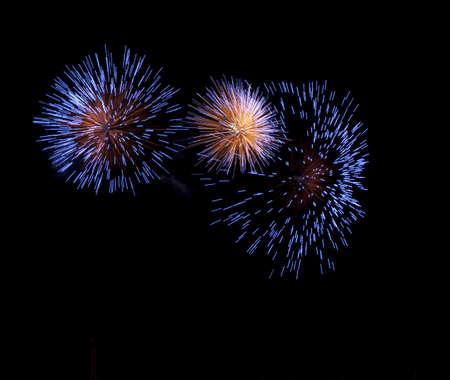 blue fireworks exploding taken at a medium shutter speed
