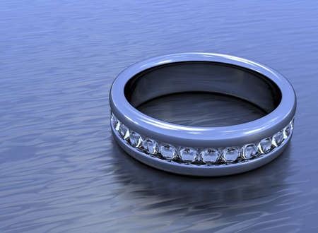 A silver ring with a ring of diamond all around, laying flat on metallic surface
