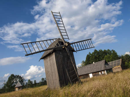 Old village with windmill, Bialowieza Poland photo