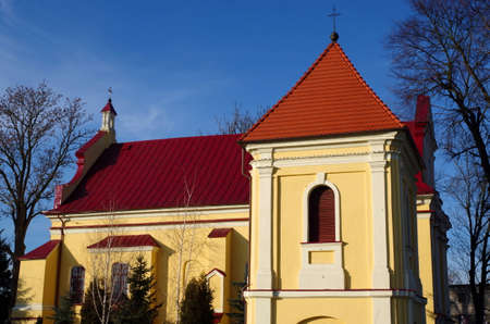 Our Lady od Scapular church in Lutomiersk with bell town