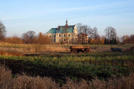 Agricultural landscape with old monastery in Lutomiersk