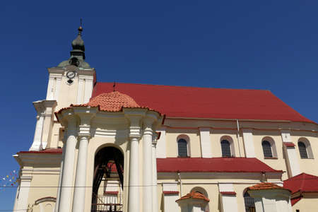 Church with belfry, a place of prayer confessing Christian religions against the blue sky on a sunny summer day in the small town of Siemiatycze.