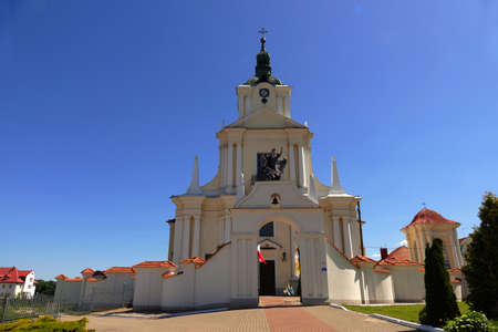 Orthodox church with belfry, a place of prayer confessing Christian religions against the blue sky on a sunny summer day in the small town of Siemiatycze. Stock Photo