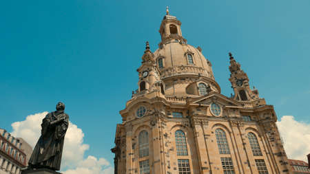 Frauenkirche Dresden - Baroque church with a characteristic dome on the background of the blue sky. Rebuilt from ruins after the destruction of the war. Stock Photo