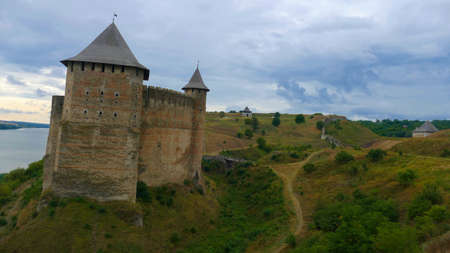 Khotyn castle in Ukraine is a powerful medieval fortress that witnessed the fighting between Poles, Cossacks and Turks. High medieval walls, towers on the background of the picturesque Dniester.