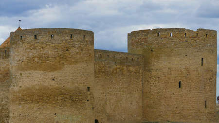 Bialogród Dniester castle in Ukraine is a powerful fortress that witnessed the fighting between Poles, Cossacks and Turks. High medieval walls, towers on the background of the picturesque Dniester. Stock Photo