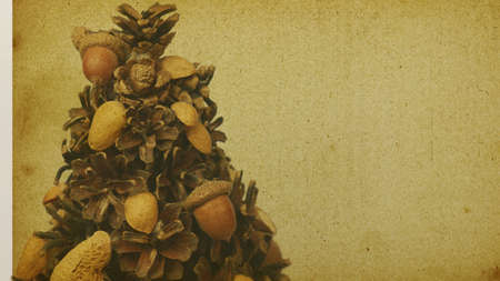Ecological Christmas tree made of natural materials. A place for Christmas greetings - sepia retro style card.