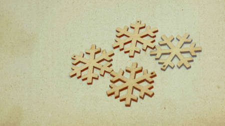 Wooden stars in retro style covered with sepia-colored texture. Image showing the festive atmosphere in the form of a Christmas card.