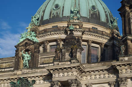Berliner Dom - cathedral in Berlin. Rich decorations and decorative sculptures of the facade of one of the most famous churches in Germany, the historic cathedral standing on the Museum Island. Stock Photo