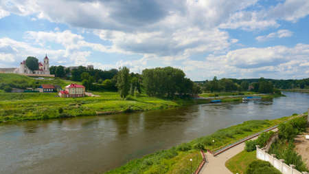 View of the Niemen in Grodno. Green clean urban space popular as a place for walks of residents. Stock Photo