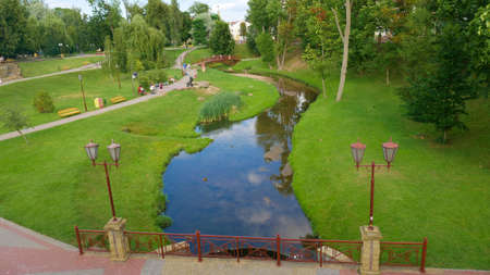 City park in Grodno. Green clean urban space popular as a place for walks of residents Stock Photo