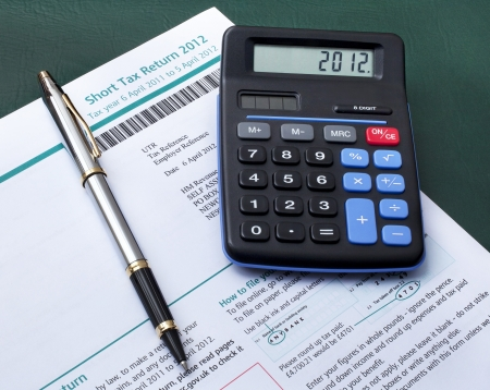 taxation: British tax return form with calculator and pen Stock Photo