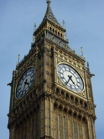 bigben: Upper part of the clock tower of the Palace of Westminster, London, against blue sky