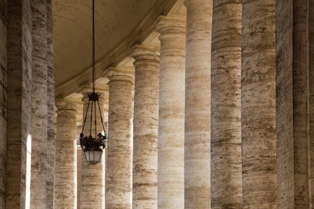 roman pillar: Bernini colonnade in St Peters Square, Rome, with hanging lamp